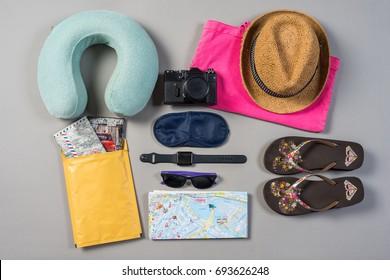 Mock up of summer traveling stuff on grey background.