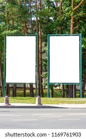 Mock up of two blank billboard, outdoors advertising boards in the city park