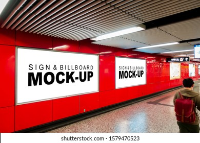 Mock up two blank horizontal billboard with clipping path placed near entrance and walkway in metro station, blurred people, empty space for advertising or information, advertising concept