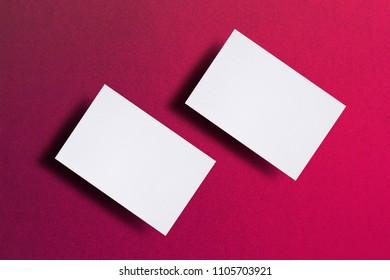 Mock up of two horizontal white business cards at pink textured paper background. Mock-up template for branding identity. For graphic designers presentations and portfolios