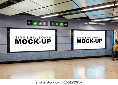 Mock up two large blank horizontal billboard with clipping path placed near entrance and walkway in metro station, blurred people walking, empty space for advertising,  information