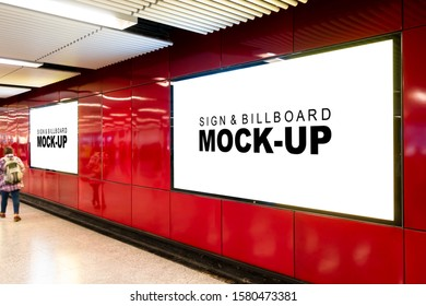 Mock up two perspective blank billboard with clipping path on red wall near entrance and walkway in metro station, blurred people walking, empty space for advertising or information