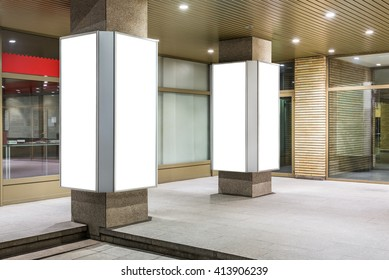 Mock up of two vertical lightboxes in city space at night