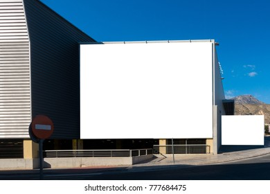 Mock up. Blank billboard on the wall of big shopping center.