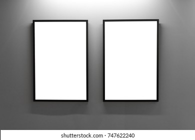Mock up. Blank picture frames on gray wall in the loft interior. Gallery wall with empty poster frames indoor