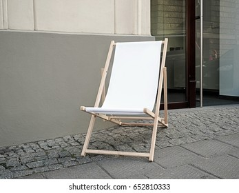 Mock up, Blank Sunbed, deck chair in a front of a shop on a pedestrian path in the old town