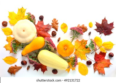 Mock up with vegetables, flowers, chestnuts and autumn leaves. Top view on white background. Autumn flat lay.