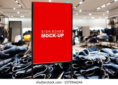 Mock up vertical blank banner or signboard in frame with clipping path to show promotion or discount in shop jeans clothing, yellow screen empty space for insert text or advertising in shopping mall