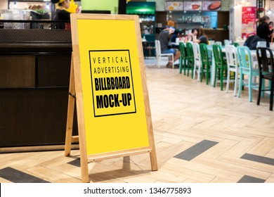 Mock up vertical blank chalkboard standing with clipping path at front of restaurant, Yellow screen empty space for insert text menu or advertising or announcement