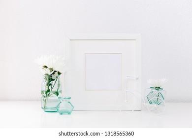 Mock up white frame and flowers . Minimal background
