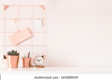 Mock up of woman workplace on light background. Business office desk with pink colors. Modern design. Minimal style.