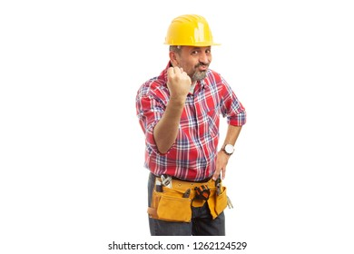 Mocking construction worker making null gesture with thumb inside fist isolated on white background