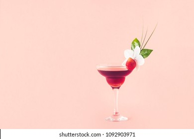 Mocktail decorated with strawberry, flower and tropical leaves,  selective focus.