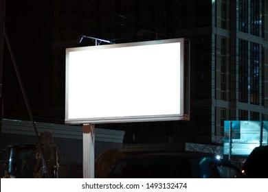 A mockup of a billboard at night