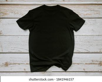 Mockup black unisex t shirt wood background flat lay