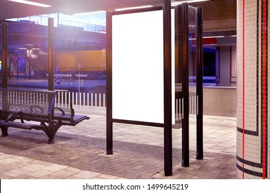 Mockup of a blank empty white advertising urban billboard indoor at the train station, space for design layout.