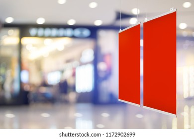 Mock-up blank red banner for advertising design promotion at shopping mall.