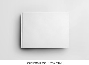 Mockup blank white closed book isolated on background, front view. Hardcover landscape orientation object template for design presentation. Ctalogue layout with realistic shadows