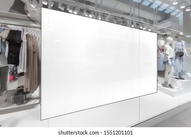 Mockup of blank white horizontal indoor advertising billboard at the storefront window in shopping centre or mall