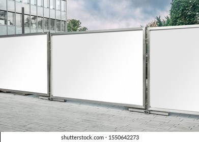 Mockup of the blank white street city outdoor advertising horizontal billboards in metal frames near corporate building