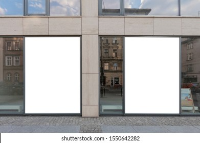 Mockup of the blank white street city outdoor advertising vertical billboards in black frames at corporate building window