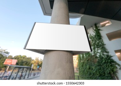 Mockup of the blank white street city outdoor advertising horizontal sign on mall entrance collumn