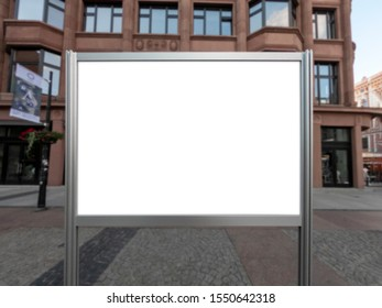 Mockup of the blank white street city outdoor advertising horizontal poster stand in silver frame at city sidewalk