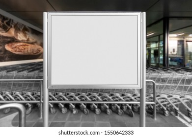 Mockup of the blank white street city outdoor advertising horizontal poster stand in silver frame at shop entrance