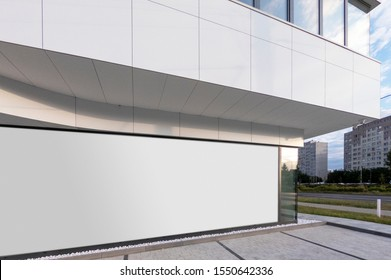 Mockup of the blank white street city outdoor advertising horizontal billboard in silver frame at corporate building window