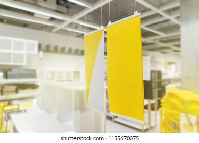 Mock-up blank yellow banner for advertising design promotion at showroom.