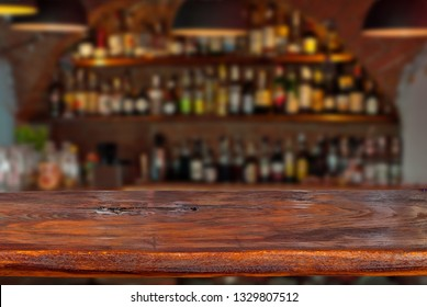 Mockup. Blurred bar in the background. A wooden board in the foreground.