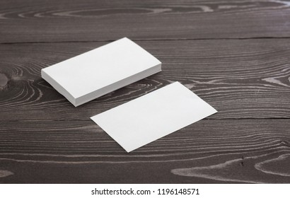 Mockup of business cards, Photo of business cards stack on a  dark wood background