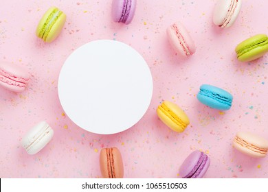 Mockup with cake macaron or macaroon on pink pastel background top view. Flat lay composition.