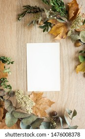 mockup card with autumn leaves. invitation card with environment and details. fall postcard mockup