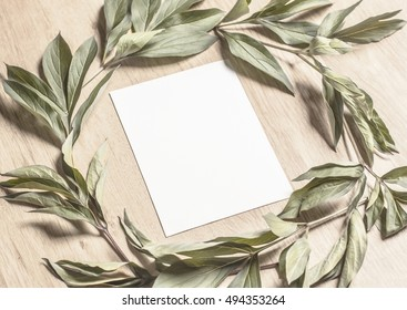 Mockup With A Card And Green Leaves