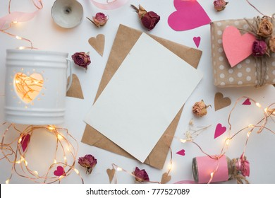 mockup card with paper hearts. Valentines invitation card with environment. garlang, lights, roses candies, gifts
