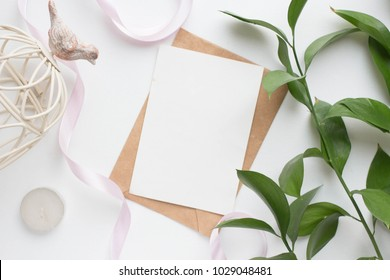 mockup card with plants. invitation card with environment and details Mockup with postcard and flowers on white background. card and pink flowers. ink pen, ink, stamp pink flowers with copy space