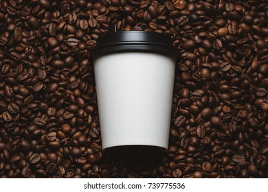 Mockup of coffee beans with white paper cup.