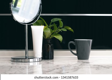 mockup container tube of product cosmetic beauty lotion spf cream with vase decoration and green herb nature leaf with mirror and coffe mug on marble table background