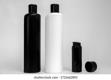 Mockup of cosmetic products isolated. Similar black and white plastic bottles with no label, for designers