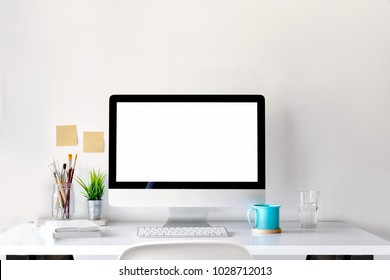 Mockup of creative desktop of designer with coffee mug.