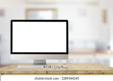 Mockup desktop computer on wood table in living room background