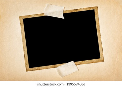 Mockup of empty old vintage photo on scotch tape on white yellowed paper background