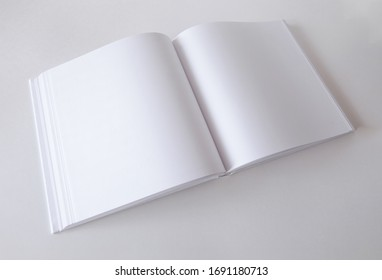 Mockup of an empty open book in square format. Template for design.