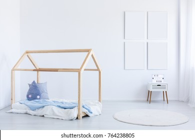 Mockup of empty posters in boy's interior with blue accent on wooden bed