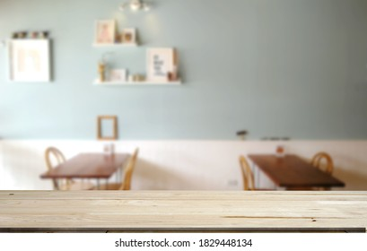 Mockup empty top wood table.Background is blur minimal interior room .It  pastel colors tone