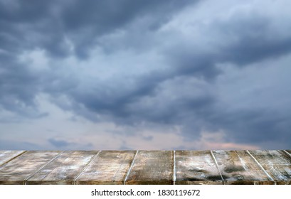 Mockup  empty top wood table.Background storm sky cloud