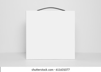 Mockup of empty white square box with carrying handle, front view, isolated on a white background