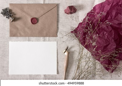 Mockup with envelope, wax seal, nib pen, blank card and dry flowers. Wedding, calligraphy vintage stationary.