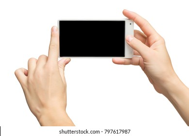 Mockup of female hands holding white frameless cellphone with black screen and making selfie at isolated background.